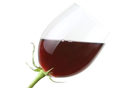 Glass with red wine as a flower isolated on white photo