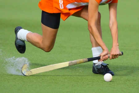 playing field: Man playing field hockey. High speed.