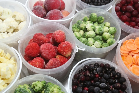 frozen fruit: Frozen summer fruits and healthy vegetables in plastic containers