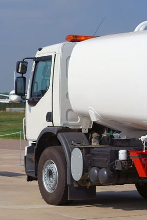 airfield: white tank truck in airfield