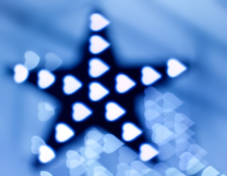 bluey: Decoration star and garland as heart lights, defocused Stock Photo