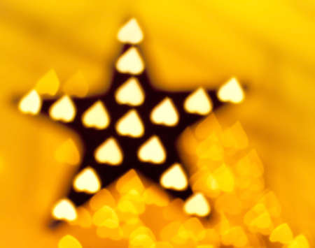 Decoration star and garland as heart lights, defocused photo