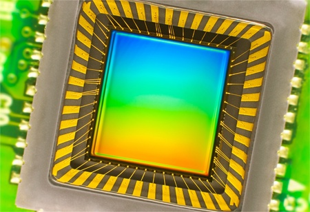 cmos: light sensor on a card of digital camera with coloured interference