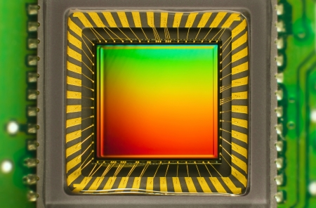 interference: light sensor on a card of digital camera with coloured interference