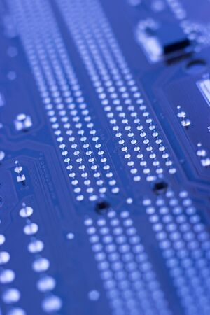 Computer printed circuit board as background, vertical photo