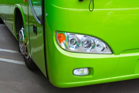 return trip: Green bus headlight and wheel