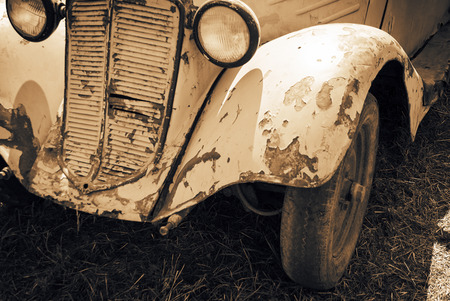 Old rusty car, sepia-styled picture photo