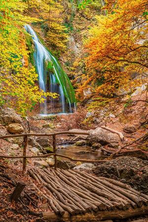 Waterfall Jur-Jur with wooden bridge, Crimea, Ukraine, hdr style shot photo