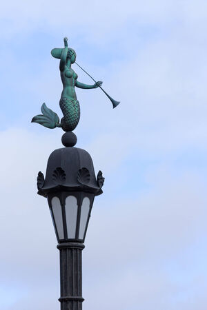 water nymph: Water nymph with trumpet street-lamp, blue sky background, Saint Petersburg, Russia