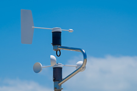 anemometer: Anemometer of weatherstation, blue sky with clouds as background