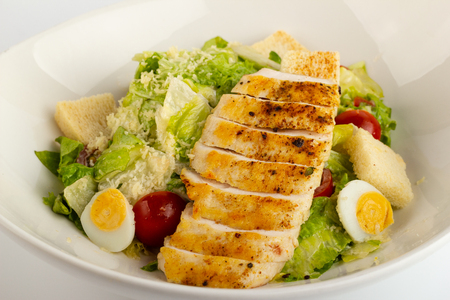 Gourmet caesar salad with grilled chicken croutons