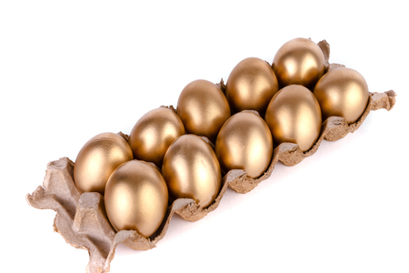 Golden egg and jast eggs in a cardboard box on a white background.