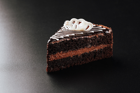 Chocolate cake on a black background.low key Standard-Bild