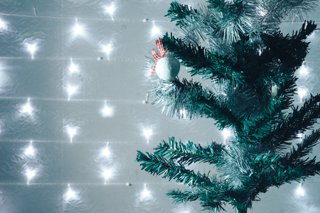 Christmas holiday blinking abstract background with decorated christmas tree.