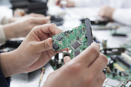 microprocessors: The hands of men with the electronic circuit Stock Photo