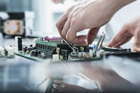 microprocessors: The hands of the engineers working in the window