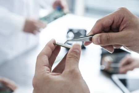 microchip: The hands of engineers to the fine work Stock Photo