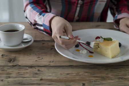 alone person: Woman eating the cake with calm cafe Stock Photo
