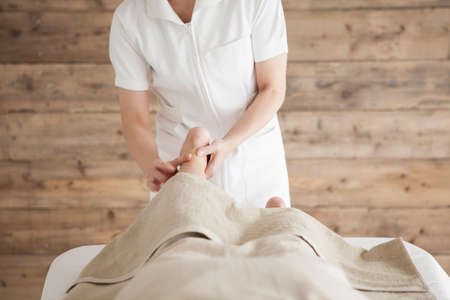 power suppliers: Woman the Achilles tendon is the massage