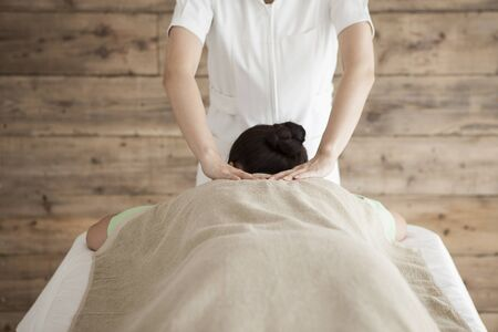 power suppliers: Woman to be massaging the neck Stock Photo