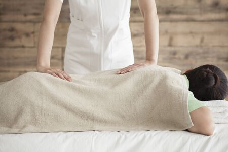 power suppliers: Woman to be massage the back and waist Stock Photo