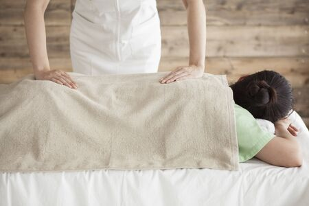 power suppliers: Woman to be massaging the shoulders and hips Stock Photo