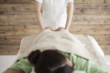 power suppliers: Woman to be massaging the ankle Stock Photo