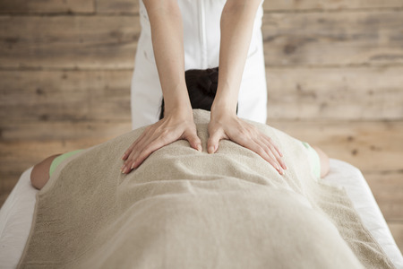 power suppliers: Woman to be massaging the back