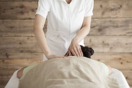 power suppliers: Woman to be massaging the shoulders and neck Stock Photo