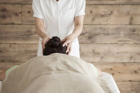 power suppliers: Woman to be massaging the head Stock Photo
