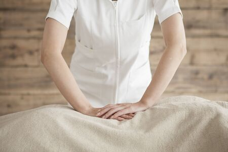 power suppliers: Woman to be massaging the waist with both hands Stock Photo