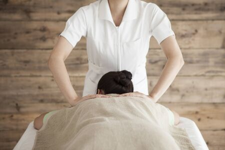 power suppliers: Woman to be massaging the shoulders with both hands Stock Photo