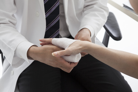 internal medicine: Male doctor bandage into the hands of the patient Stock Photo