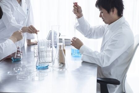white coat: Three scientists to diligently research Stock Photo