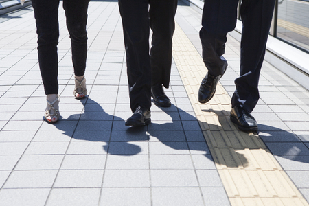 walkway: Image of the business group going along office building Stock Photo