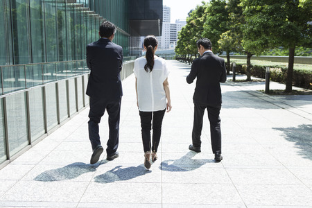 people walking: Image of the business group going along office building Stock Photo