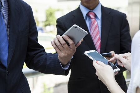 businessman phone: Three Businessman meeting and using mobile phone on white background