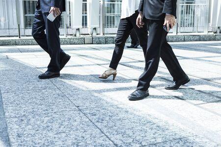 go inside: Business people walking in the office corridor