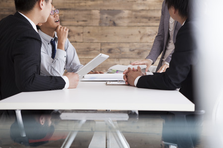 Image of laughing confident people planning a business-strategy