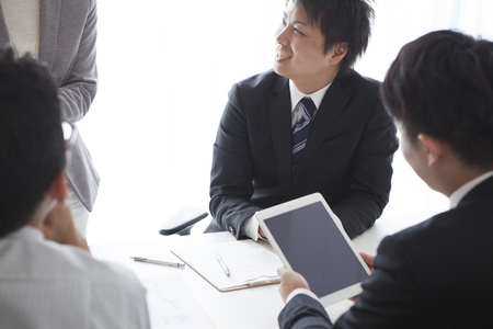 teamworking: Image of laughing confident people planning a business-strategy