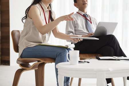 Asian business Man and woman working together on a laptop