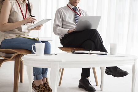 co work: Asian business Man and woman working together on a laptop