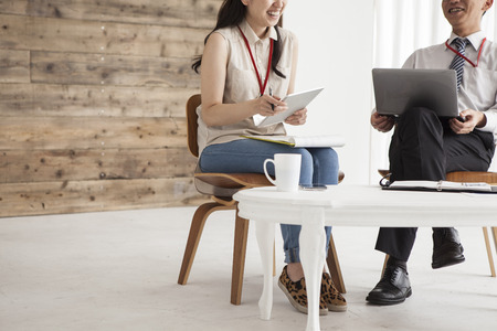 co worker: Young business people are working in the meeting room. Stock Photo