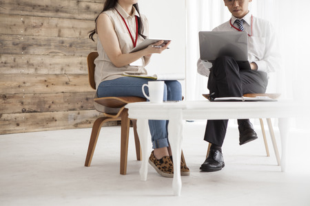 co work: Young business people are working in the meeting room. Stock Photo