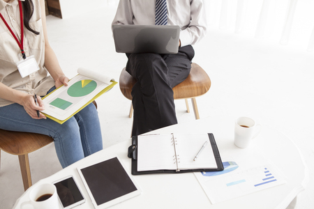 Men and women who are working together in a bright office