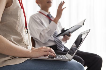 co work: Men and women who are working together with a laptop