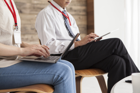 co work: Men and women using a laptop are working