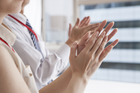 Businessmen and women have a clap Banque d'images