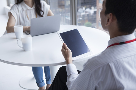 co work: Customer and consultant at office-consultation. Stock Photo