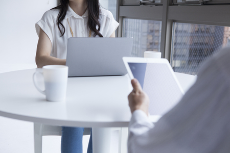 co work: businessman and businesswoman during a working meeting Stock Photo